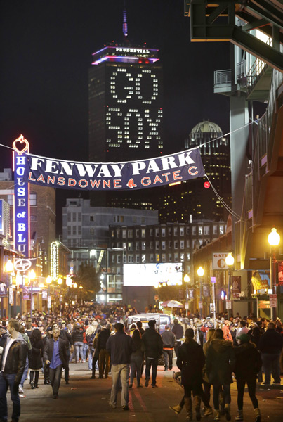 "The words ""Go Sox"" are illuminated on a side of the Prudential Tower before game. (AP Photo/Steven Senne)"