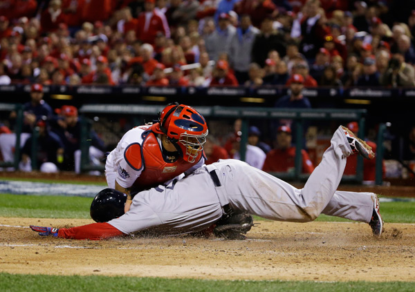 David Ross slides into home during last night's Red Sox-Cardinals game. Ross was ruled out but his double proved to be the game-winning hit in Boston's 3-1 victory. (AP Photo/Matt Slocum)