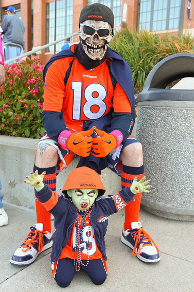 Halloween came early for this Broncos fan and his son. (Dilip Vishwanat/Getty Images)