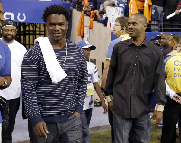 Colts legends Edgerrin James and Marvin Harrison attend Peyton Manning's return to Indianapolis last night. (AP Photo/Michael Conroy)