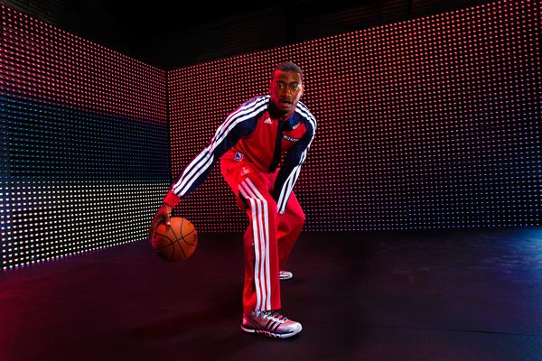 John Wall models the Wizards' new warm-up jacket. (Adidas)