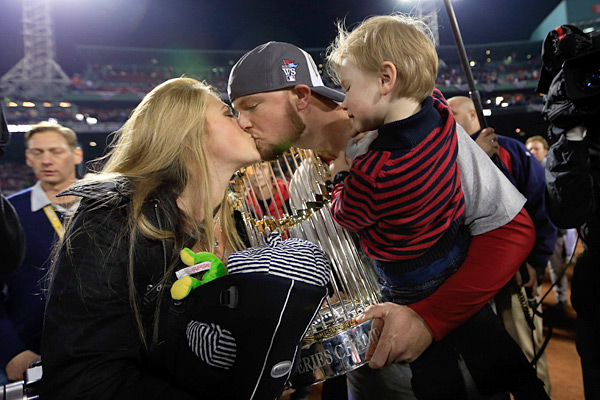 Jon Lester and family after the game. (Jamie Squire/Getty Images)