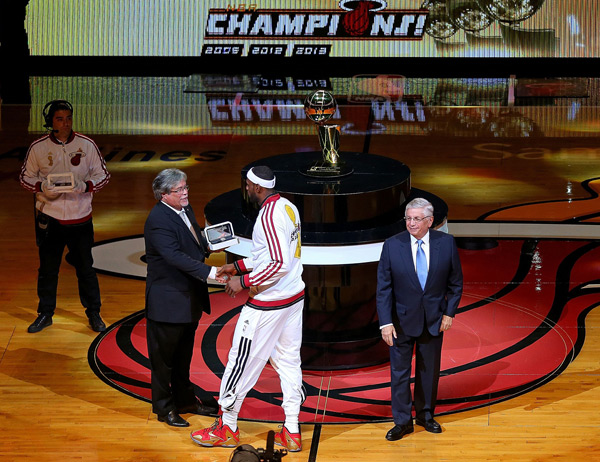 LeBron James recieves his championship ring before Tuesday's season opener against the Bulls. (Mike Ehrmann/Getty Images)