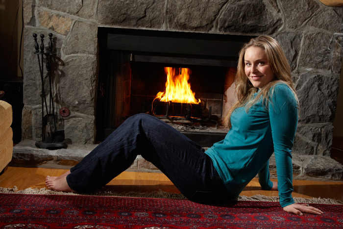 Vonn stays warm by the fire during a 2008 SI photo shoot. (Heinz Kluetmeier/SI)