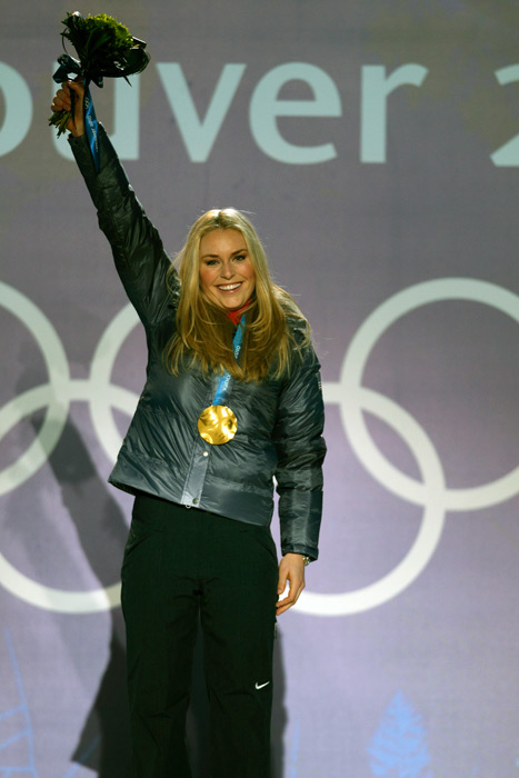 Vonn celebrates her gold medal after winning Women's Downhill Final gold in Whistler during the 2010 Olympics. (Simon Bruty/SI)