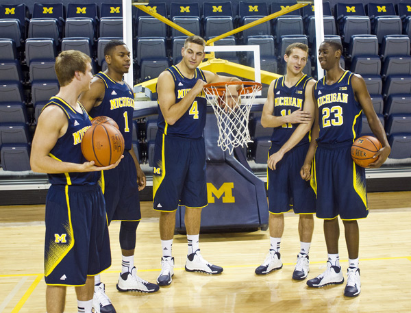 Michigan sophomores Spike Albrecht, Glenn Robinson III, Mitch McGary, Nik Stauskas and Caris LeVert joke around at Media Day on Thursday. (AP/Tony DIng)