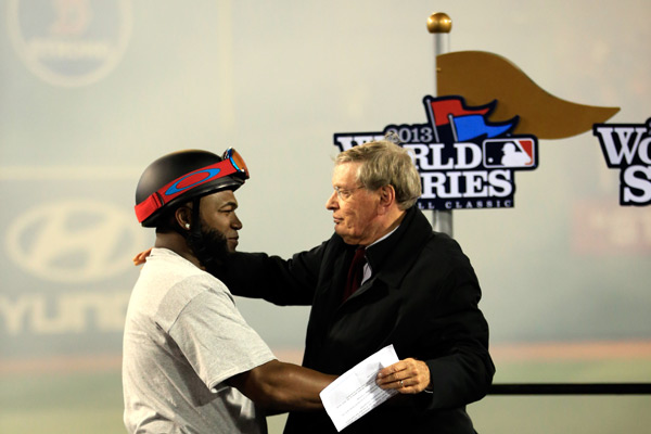 Bud Selig and David Ortiz embrace after Big Papi was awarded the World Series MVP Trophy. (Jamie Squire/Getty Images)