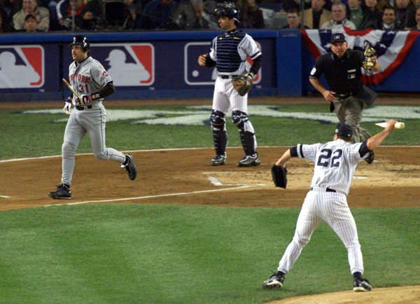 On this day in 2000, Roger Clemens famously Roger Clemens threw the barrel of a shattered bat at Mike Piazza during Game 2 of the World Series. (AP)