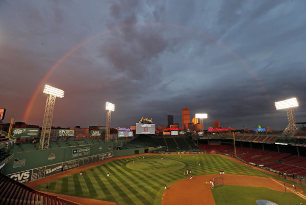 A rainbow appears over Fenway Park yesterday as the Red Sox took batting practice. (AP/Charles Krupa)