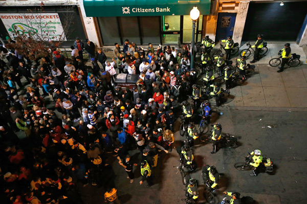 Boston Police officers move fans away from Fenway Park during Game Six . (Jim Rogash/Getty Images)