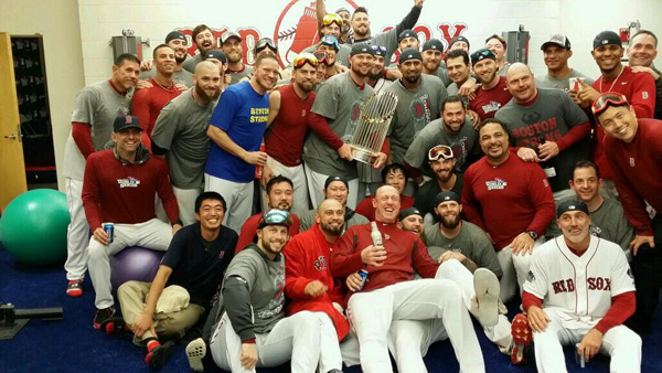 The Red Sox pose for a team photo in the locker room. (@John_W_Henry)