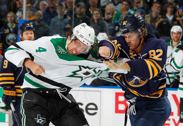 Buffalo's Marcus Foligno and Dallas' Brenden Dillon exchange punches during Monday's Stars-Sabres matchup. (Bill Wippert/NHLI via Getty Images)
