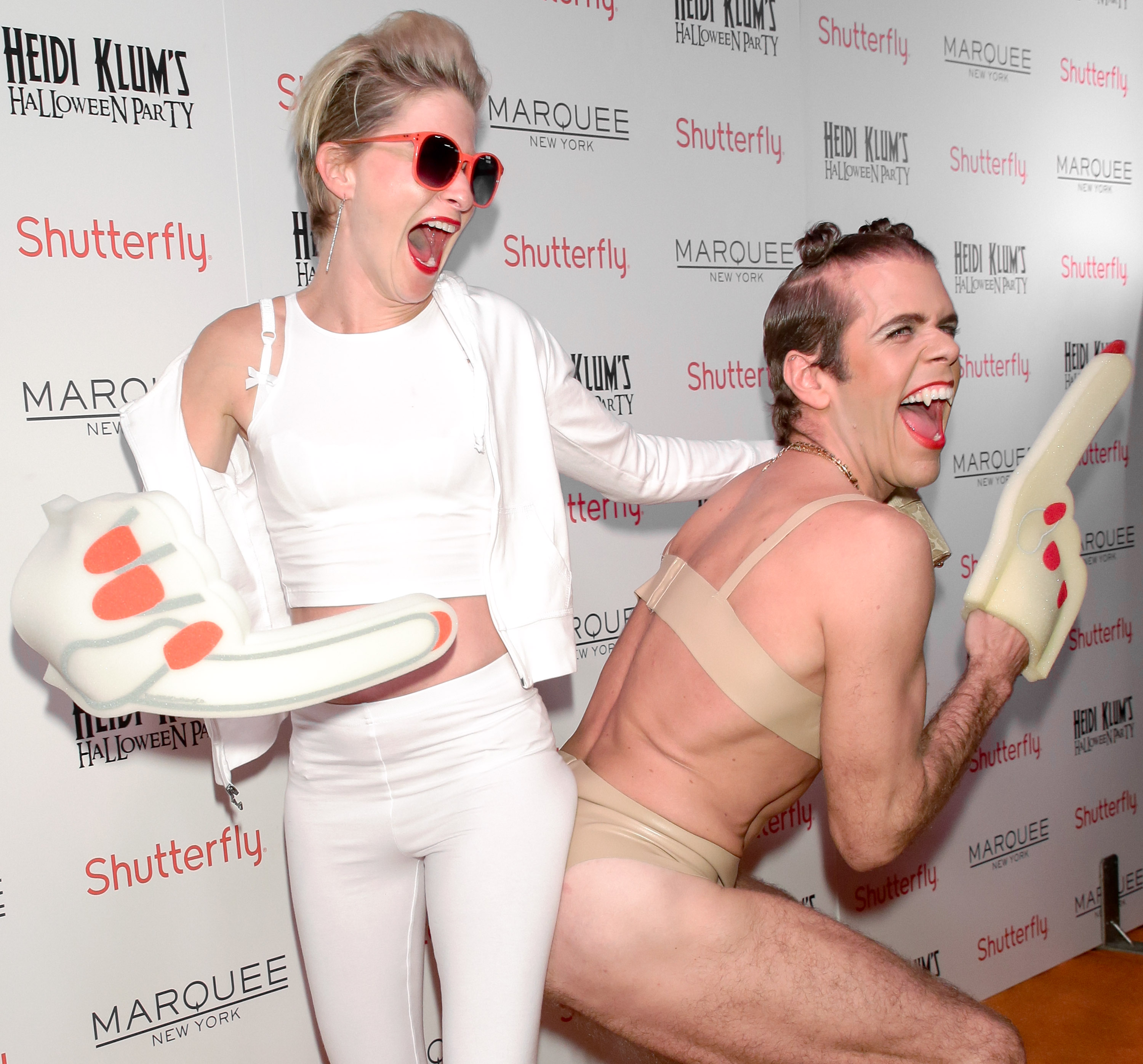 Socialite Julie Macklowe and blogger Perez Hilton) :: Andrew Toth/FilmMagic