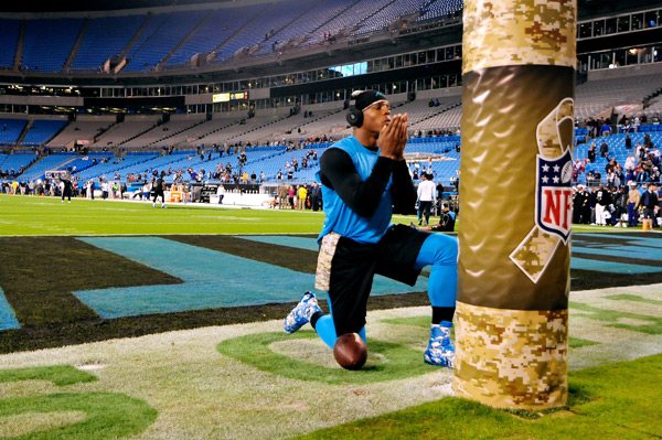 Cam Newton  blows a kiss into the air before the game. (Grant Halverson/Getty Images)