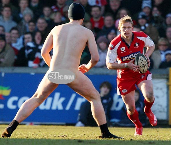Gloucester's Iain Balshaw is confronted by a streaker during the Guinness Premiership match between Bristol and Gloucester in Bristol, England.