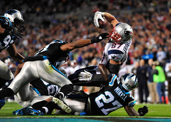 Rob Gronkowski drags three tacklers into the endzone. (Grant Halverson/Getty Images)