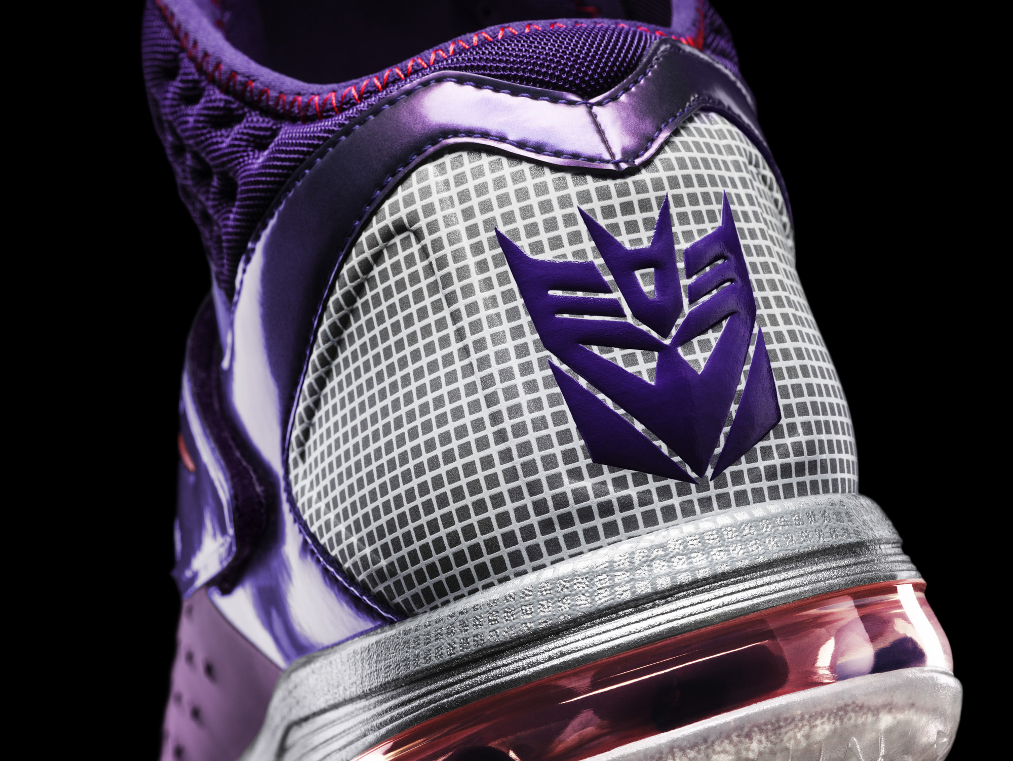 The Decepticon logo appears on the Megatron Trainer Max