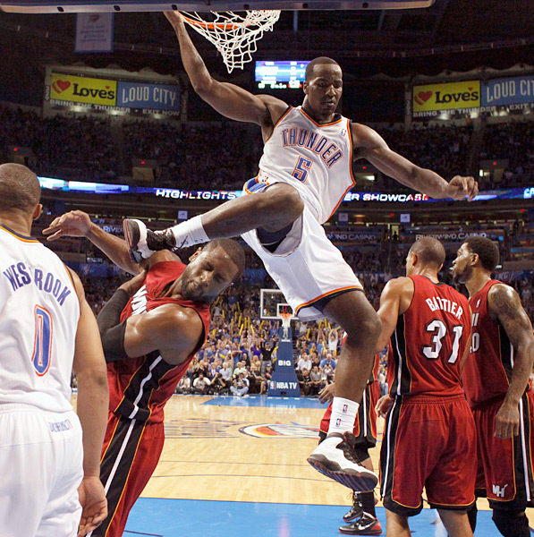 Kendrick Perkins and Dwyane Wade (2012) :: REUTERS/Bryan Terry