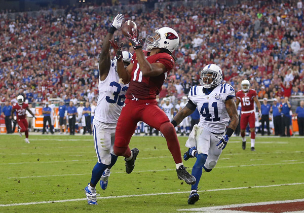 Larry Fitzgerald, Cassius Vaughn and Antoine Bethea :: Christian Petersen/Getty Images