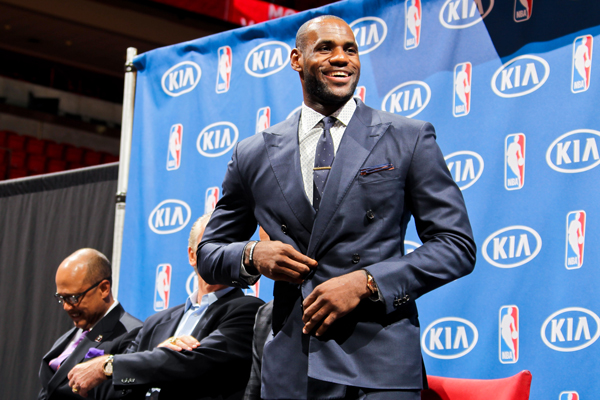 LeBron James in a blue suit to receive his fourth MVP award. (Issac Baldizon/Getty Images)