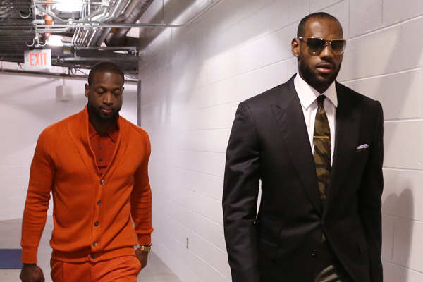 LeBron James (right) and Dwyane Wade (left) showcase their differing tastes before a game. (Nathaniel S. Butler/Getty Images)