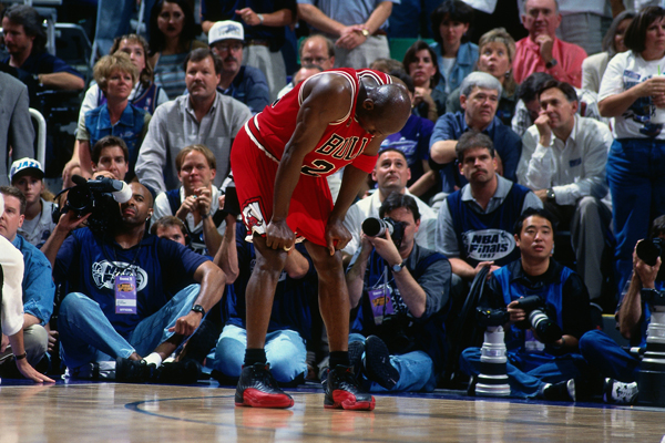 "Michael Jordan doubled over during the ""Flu Game."" (Dick Raphael/Getty Images)"