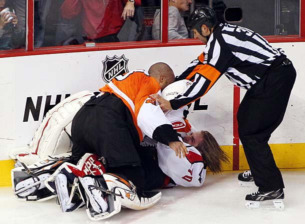 RAY EMERY: With the NHL pondering harsher penalties for fighting, the Flyers' hotheaded goalie picked a bad time to go psycho. When a scrap broke out during the third period of a 7-0 whupping by Washington, Emery left his crease to pummel counterpart Br