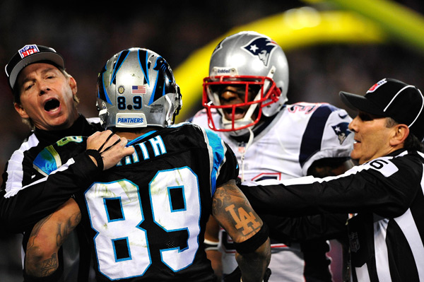 Aquib Talib and Steve Smith exchange words. (Grant Halverson/Getty Images)