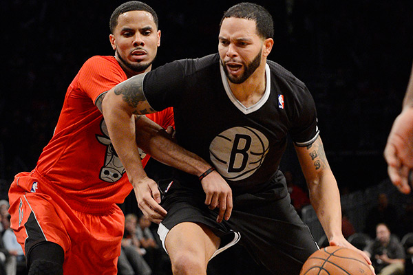 Nets guard Deron Williams (right) in his Christmas Day jersey. (Christopher Pasatieri//NBAE/Getty Images)