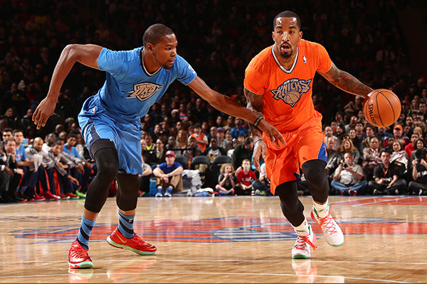 Thunder forward Kevin Durant (left) and Knicks guard J.R. Smith (right) in their Christmas Day jerseys. (Nathaniel S. Butler/Getty Images)