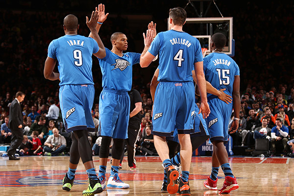 The Thunder model their Christmas Day jerseys. (Nathaniel S. Butler/NBAE/Getty Images)