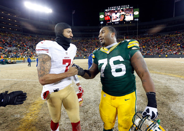 Colin Kaepernick and Mike Daniels :: AP