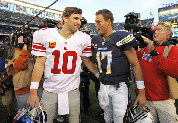 Eli Manning and Philip Rivers :: AP Photo/Denis Poroy