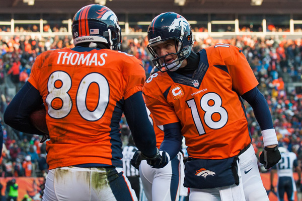 Julius Thomas and Peyton Manning :: Dustin Bradford/Getty Images