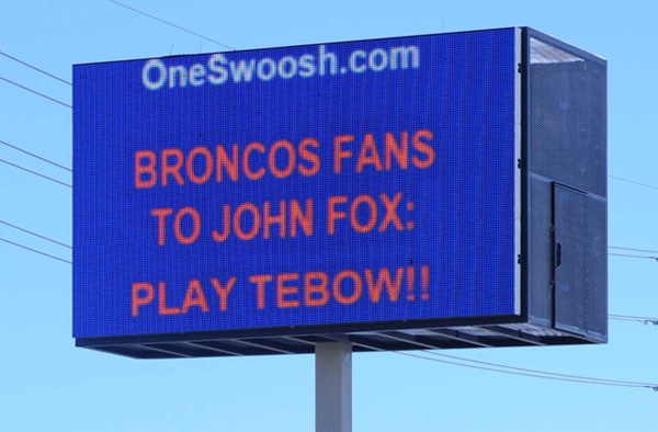 Bronco fans try and urge Coach John Fox to bench Kyle Orton and play Tim Tebow. (Ron Chenoy/US PRESSWIRE)