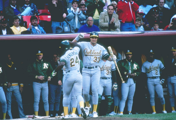 Rickey Henderson and Jose Canseco :: Getty Images