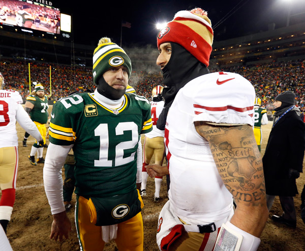 Aaron Rodgers and Colin Kaepernick :: AP