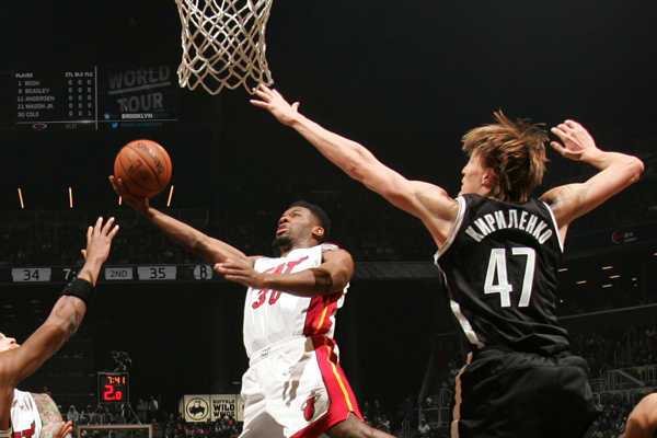 "Nets forward Andrei Kirilenko wears his ""Кириленко"" nickname jersey. (Nathaniel S. Butler/Getty Images)"