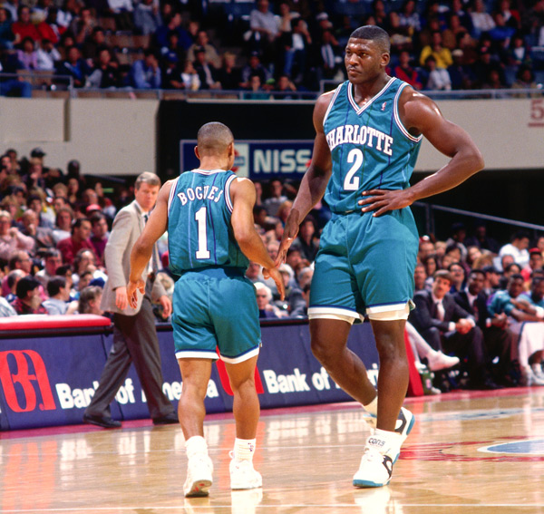 Muggsy Bogues and Larry Johnson :: Getty Images