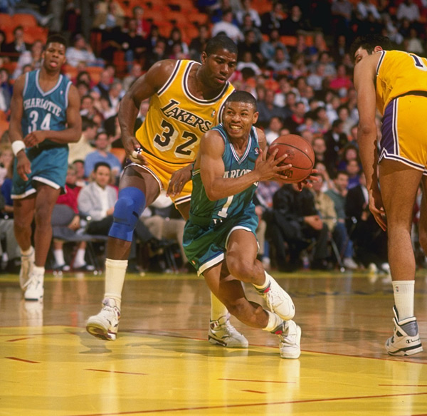 Magic Johnson and Muggsy Bogues :: Getty Images