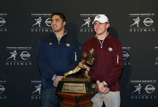Heisman finalists  Manti Te'o and Manziel at a press conference in Dec. 2012. (Kelly Kline/Getty Images