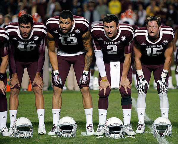 "Manziel and teammates during playing of ""The Spirit of Aggie Land""  in Nov. 2013. (Bob Levey/Getty Images)"