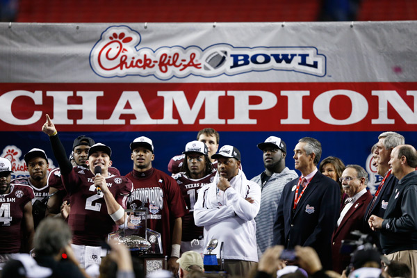 Manziel and teammates after beating Duke in the Chick-fil-A Bowl last week. (Joe Robbins/Getty Images)