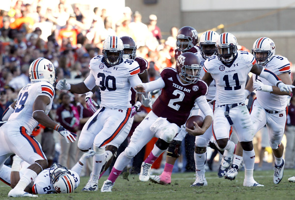 Manziel scrambles during Oct. 2013 game against Auburn. (Thomas B. Shea/Getty Images)