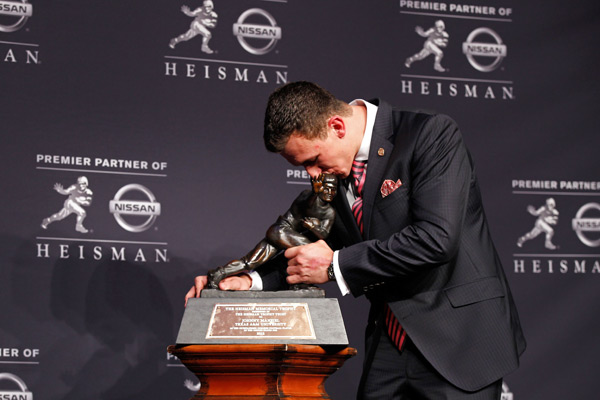 Manziel wins the Heisman in Dec. 2012. (Mike Stobe/Getty Images)