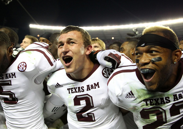 Manziel celebrates a Nov. 2012 victory over Alabama. (Mike Zarilli/Getty Images)