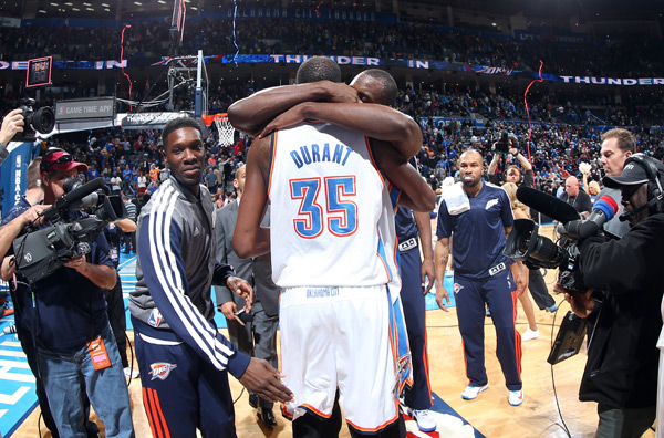 Kevin Durant and Serge Ibaka :: Layne Murdoch/NBAE via Getty Images