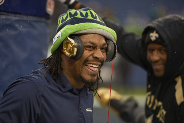 Lynch is all smiles on the sideline during a a playoff victory over the Saints earlier this month. (Robert Beck/SI)