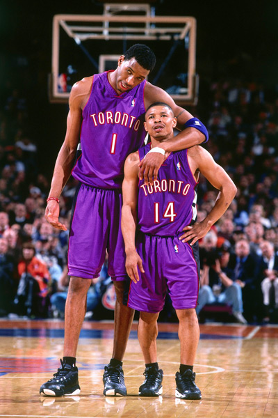 Muggsy Bogues and Tracy McGrady :: Getty Images