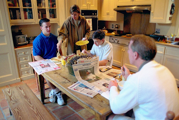 Peyton enjoys breakfast with his father Archie, younger brother Eli and mother Olivia at their home in New Orleans. (Patrick Murphy-Racey/SI)